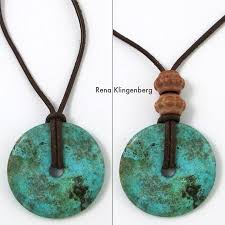 glass pendant on leather cord