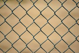 Unique Weathering Pattern Creates Fascinating Geometric Ripples On A Chain Link Fence Colossal