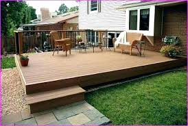 patio vs deck concrete decks wood how