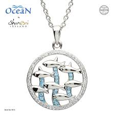 silver dolphin pendant encrusted with
