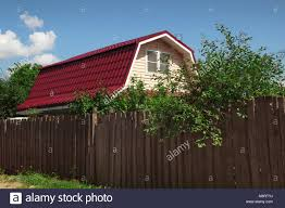 Small Country House Hidden Behind A High Fence Stock Photo Alamy