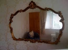 large gold baroque mirror the world