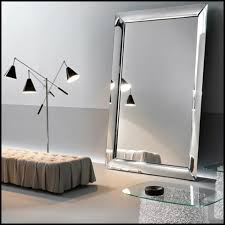 wall mirror framed by 4 glass curved