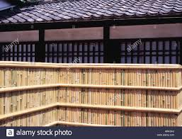 Bamboo Fence And Japanese Roof Tiles Called Kawara Stock Photo Alamy