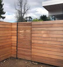 Horizontal Fencing Of Tight Knot Cedar Or Better And Gate With Varied Slat Width Modern Fence Design Wood Fence Design Modern Fence