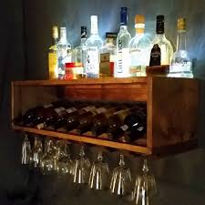 lighted wine bottle and glass rack