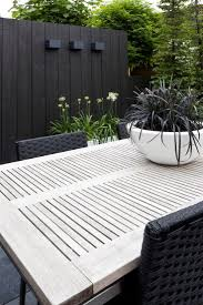 Black Painted Fences Disappear I Painted Mine Black They Accent Your Plants And Look Classy Modern Fence Backyard Fences Fence Design