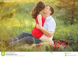 hot young couple kissing in park stock