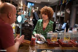 Landlady Abigail Bennett works behind the bar in the community-owned...  News Photo - Getty Images