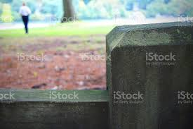 Fence Post With Person Standing In Background Stock Photo Download Image Now Istock