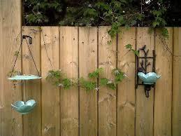 Diy Wall Mounted Bird Feeder And Bird Bath Offbeat Home Life Diy Bird Feeder Diy Bird Bath Bird Feeders