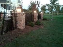 Custom Masonry Columns With Stone Veneer And Black Aluminum Fencing Modern Fence Backyard Fences Cheap Fence