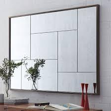 multi panel foxed mirror living room