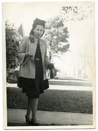 Gloria Roberts standing in front of her home on Jefferson ...