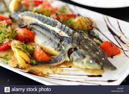 sturgeon baked with greens fruits and ...