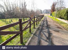 Driveway With Wooden Fence Stock Photo Alamy