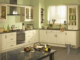 sage green walls cream kitchen