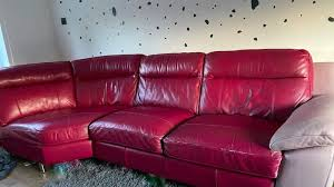 red leather sofa with baby pink paint