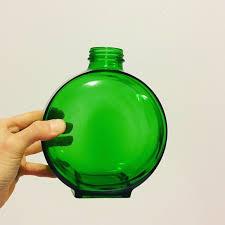 vintage large round green glass bottle