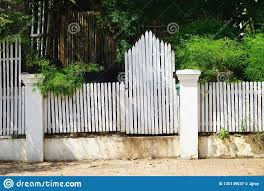 Vintage White Picket Fence And Gate On A Sunny Street In Luang Prabang Laos Stock Image Image Of Lush Street 135139537