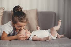 Image result for kids meeting their newborn sibling""