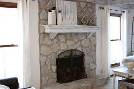 painted stone fireplace before and