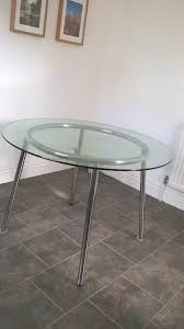 round glass dining table with chrome