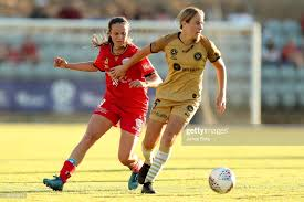 Emily Condon of Adelaide United tackles Courtney Nevin of Western... News  Photo - Getty Images