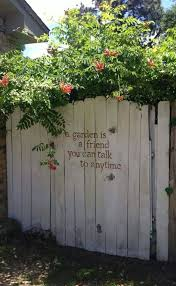 15 Stunning Fence Painting Designs To Inspire Your Own Backyard