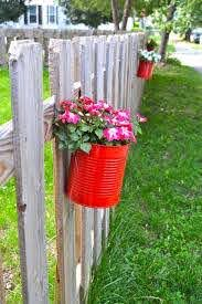 Making Fence Planters From Cans Newlywoodwards Fence Planters Diy Hanging Planter Container Gardening Flowers