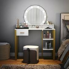 vanity table with lighted round mirror