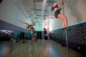 locals train for a regional pole dance