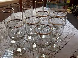 crystal glasses with gold rim tosting