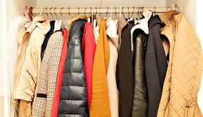 pack large winter jackets in a suitcase