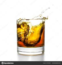 whisky glass with splashes isolated on