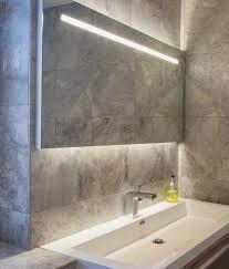 wide illuminated bathroom mirror with