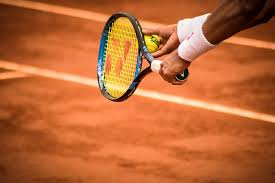 photo of person holding tennis racket