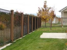 Black Metal Fence With Wood Posts Brick Fence Fence Landscaping Metal Fence Posts