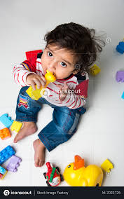indian baby boy playing with toys photo