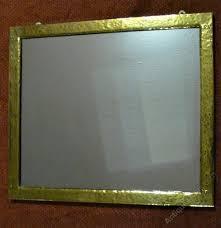 brass framed arts crafts wall mirror