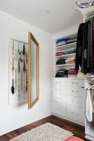 jewelry cabinet behind mirror