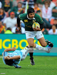 Adrian Jacobs of South Africa drives through with the ball during the...  News Photo - Getty Images