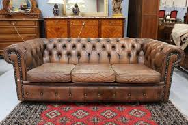 brown leather couch in distressed