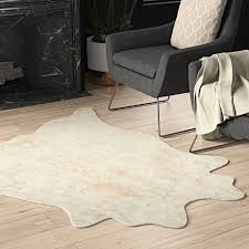 hand tufted faux cowhide ivory area rug