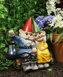 large mr and mrs gnome couple on tree