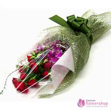 red roses and dendrobium orchids bouquet
