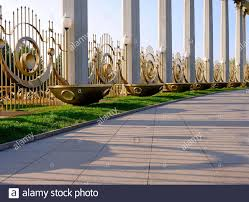 Architectural Details Lanterns Fence Flowerbeds And Columns Of Exquisite Shape In Asian Style At The Entrance To Public Park In Kazakhstan At Sunse Stock Photo Alamy