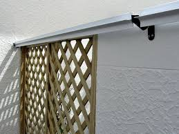 Cat Fence Nz On Twitter Today We Installed These Arctic White Oscillot Paddles With Brackets In An Auckland Courtyard The Fence Is A Combination Of Timber Lattice And Concrete Https T Co Cfibnklceq