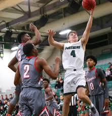 Palo Verde's Antonio Maillaro (4) goes to the basket past Arbor View's  Favour Chukwukelu (2) and Adrian Armstrong (5) during a basketball game at  Palo Verde High School in Las Vegas on