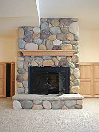 river rock fireplace afterimage interior